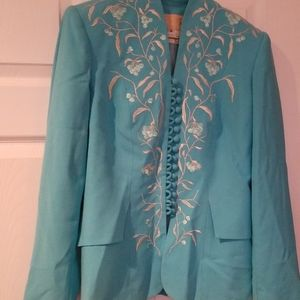 Beautiful blue blazer with design going down the f